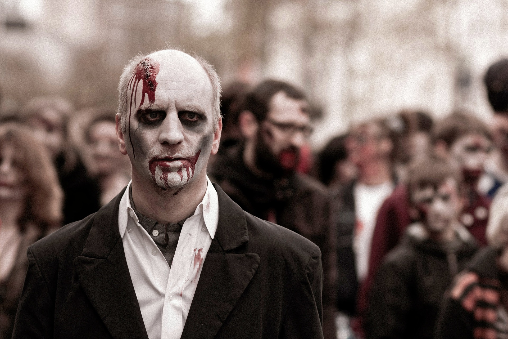 Picture of a man in suit dressed up as a zombie